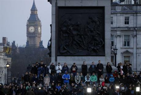 People observe a minutes silence at a vigil for the victims of Wednesday's attack, at Trafalgar Square in London, Thursday, March 23, 2017. The Islamic State group has claimed responsibility for an attack by a man who plowed an SUV into pedestrians and then stabbed a police officer to death on the grounds of Britain's Parliament. Mayor Sadiq Khan called for Londoners to attend a candlelit vigil at Trafalgar Square on Thursday evening in solidarity with the victims and their families and to show that London remains united. (AP Photo/Matt Dunham)