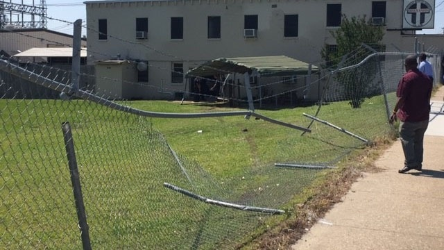A city of Jackson truck hits and kills a pedestrian and then crashes through a fence and an awning into Gateway Rescue Mission. PHOTO: Gateway Rescue Mission