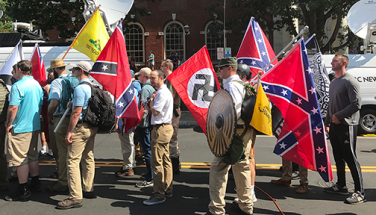 "UNITETHERIGHTRALLY Alt-right members preparing to enter Emancipation Park holding Nazi, Confederate and Gadsden ""Don't Tread on Me"" flags in Charlottesville, Va. photo by Anthony Crider/Wikimedia Commons"