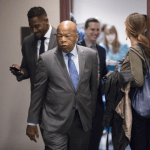 In this Nov. 29, 2017, file photo, Rep. John Lewis, D-Ga., and other members of the House Democratic Caucus leave a meeting on Capitol Hill in Washington. Lewis will speak at the Mississippi Civil Rights Museum, months after refusing to join President Donald Trump there. A private group called Friends of Mississippi Civil Rights Inc. announced Tuesday, Jan. 16, that it will give an award to Lewis, who helped lead the historic 1965 march across the Edmund Pettus Bridge in Selma, Ala. AP Photo/J. Scott Applewhite, File