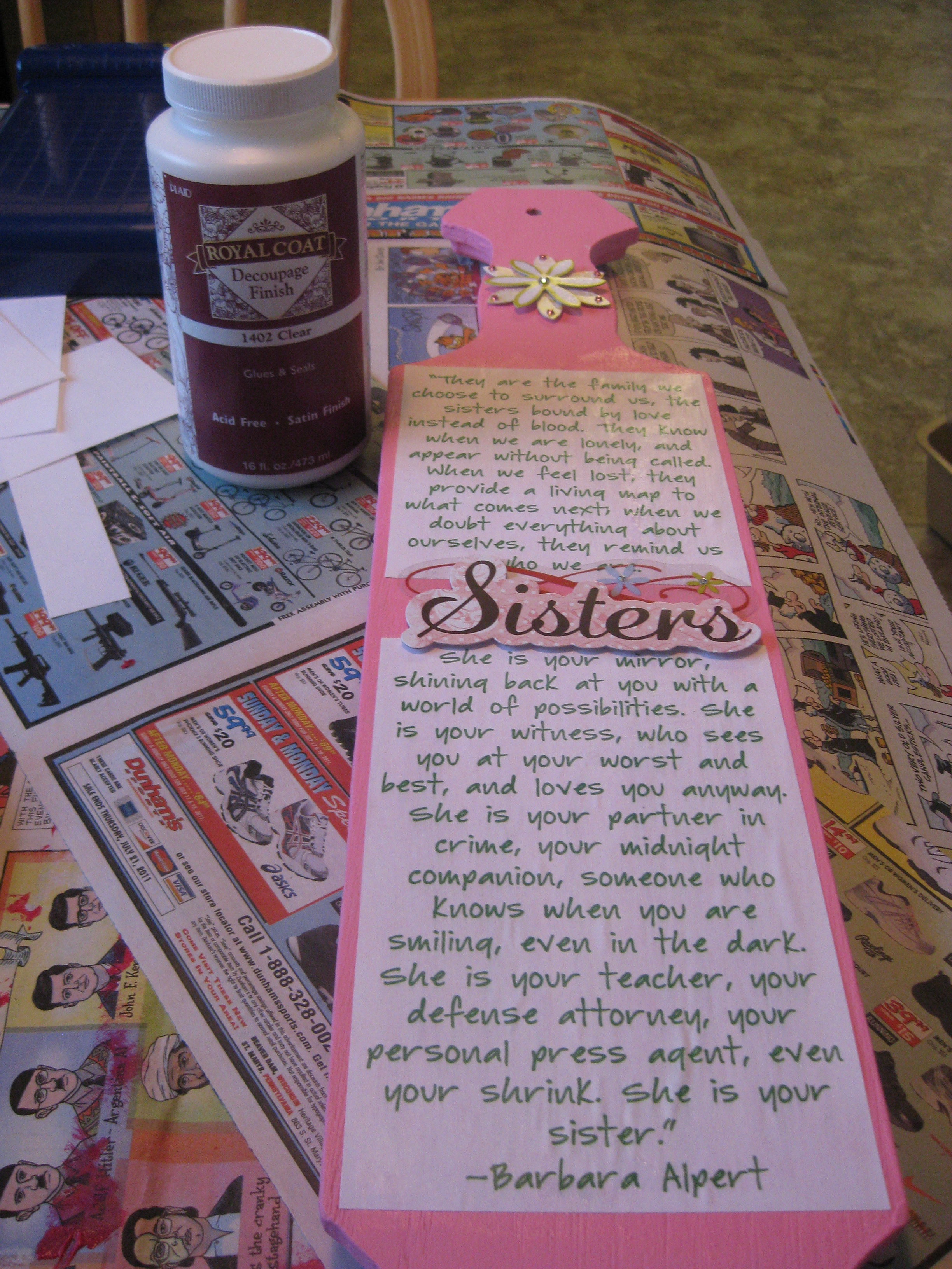 on the back i mod podged one large quote and two cute scrapbook