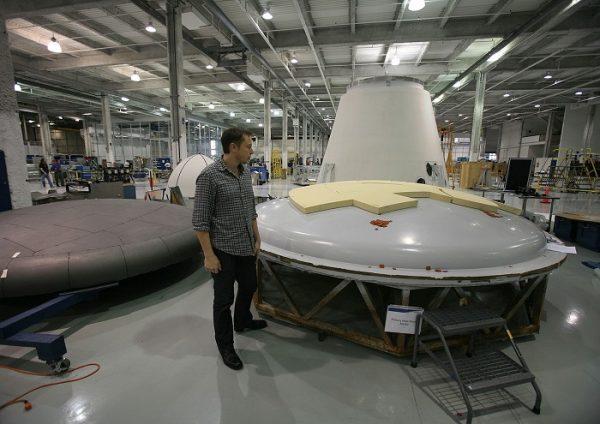 Elon Musk inspecting a heat shield