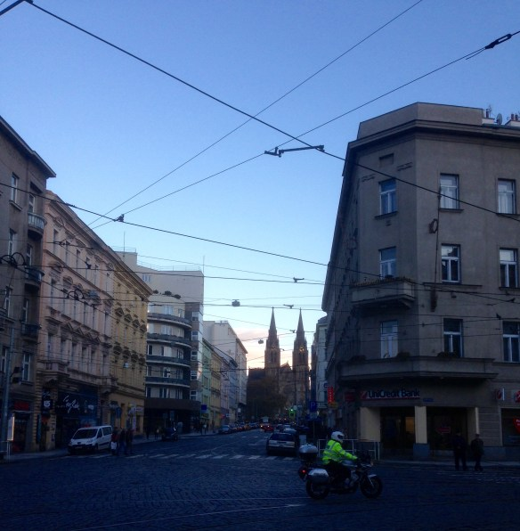 """One of Prague's many names is """"The City of 1000 Spires"""". Here are just a couple of them in the distance. It's one of the cool things about being in a city like this; even the ordinary street scenes can surprise you with sudden history, art and architecture."""