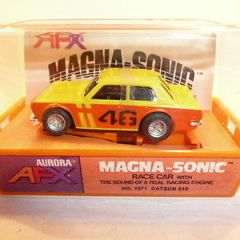 AURORA AFX SLOT CAR MINT IN ORIGINAL CASE. BANDED AND NEVER REMOVED FROM PACKAGE