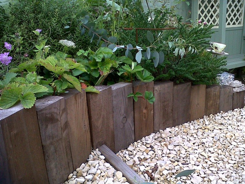 Garden bed - retaining created with vertical railway sleepers - Design Of Retaining Walls Examples