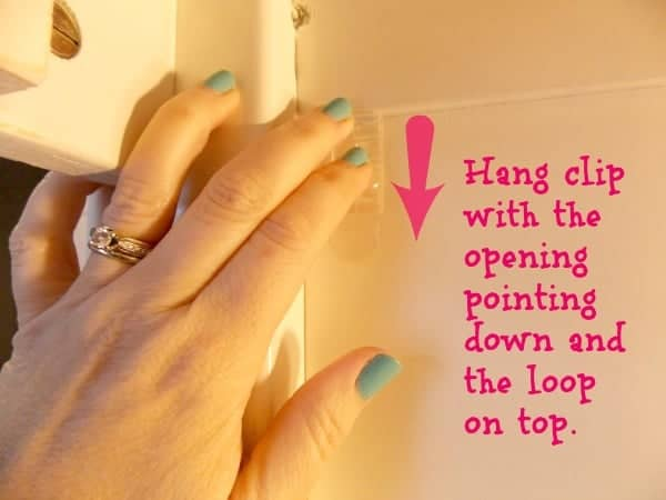 Hang clips upside down on top bunk frame
