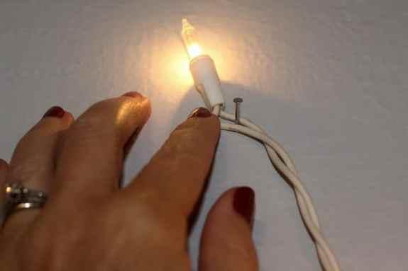 Headboard-lights-hang-light-string-on-nail