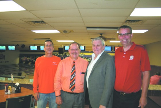OFFICIALS WITH THE Midwest Professional Basketball Association stopped by Victory Lanes bowling alley owned by Scot Banks. They included from left, Banks; Buzz Zeller, project manager of the Basketball Museum of Illinois to be opened in Pontiac next June; Ed Schumer, CEO of the MPBA; and Mark Myre, coordinator of the Pontiac team, the Pontiac 66ers.