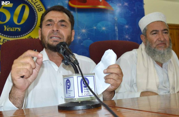 PESHAWAR: All Fata Political Alliance president Iqbal Afridi, addressing a press conference at PPC. INP PHOTO by Zeeshan Liaqat