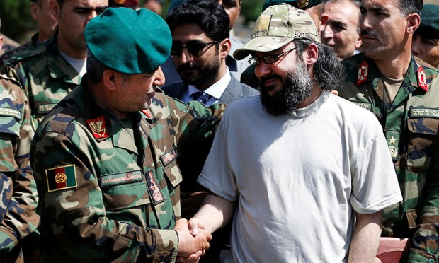 Ali Haider Gilani, (R) son of former Pakistani prime minister Yusuf Raza Gilani, shakes hands with Afghan Joint Chief of Staff Gen. Qadamshah Shahim after he was rescued in Afghanistan in a joint operation by Afghan and U.S. forces, at the Defence Ministry in Kabul, Afghanistan May 11, 2016. REUTERS/Mohammad Ismail