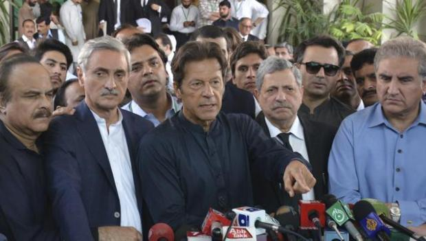 Pakistan's cricketer turned politician Imran Khan, center, talks to journalists outside the Supreme Court in Islamabad on Thursday. (AP Photo)
