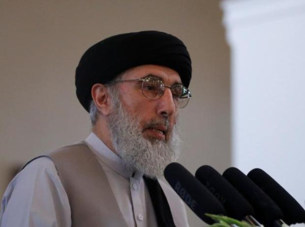 Afghan warlord Hekmatyar speaks during a welcoming ceremony at the presidential palace in Kabul