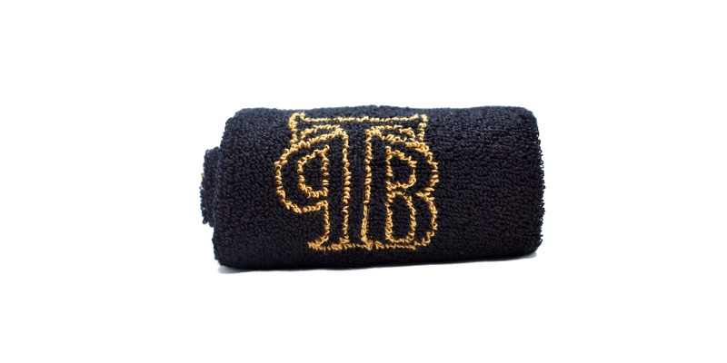 Black and gold shaving towel with TPB logo