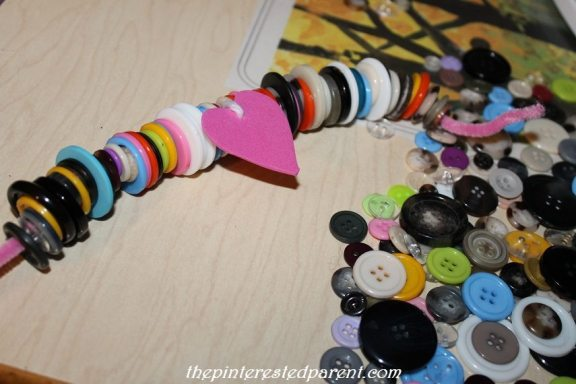 Stringing buttons for teaching fine motor skills & patterns