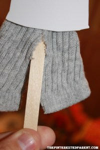 Cut the bottom portion of his sock up the center to give the appearance of pants.
