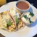 My room service breakfast: breakfast tacos with beans and sour cream.
