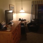 My room had a dresser, flat-screen, side table and two leather armchairs, but what's with the motel-style overhead lamp?