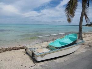 Fishing boats on the shore of Eleuthera, Bahamas - Photo by Melanie Wynne