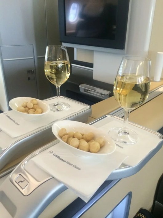 A bowl of macadamia nuts plus more Champagne equals a great way to get settled in for a long flight