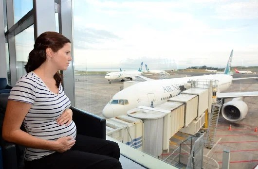 Flying while pregnant is actually quite safe. (Image courtesy of Shutterstock).
