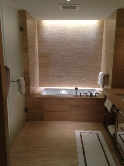 The luxurious bathroom, including a deep, recessed tub at the far end.