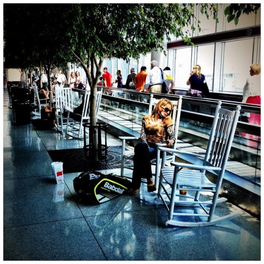 Rocking chairs in Charlotte's airport (PJ Mixer/Flickr)