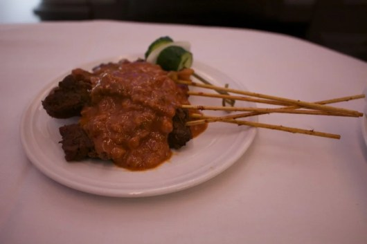 The satay skewers were delicious.