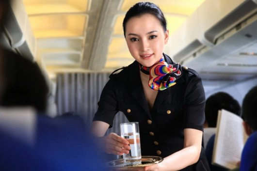 Asian and middle East carriers love to hire flight attendants when they're young - around 21. Photo courtesy of Shutterstock.