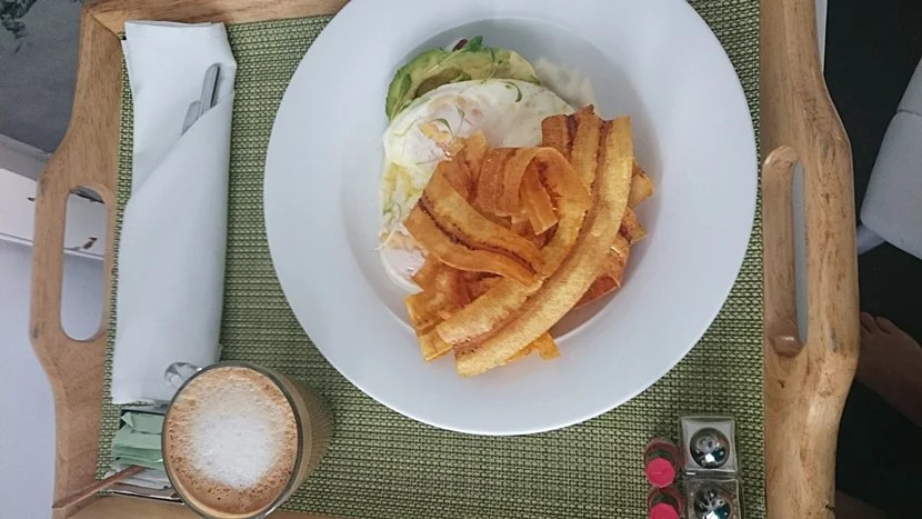 Eggs with avocado and plantain chips.