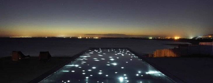 This pool is best seen at night, thanks to its illuminated floor