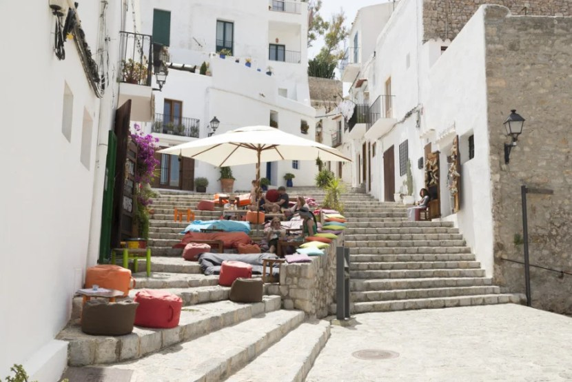 In addition to delicious tapas and seafood, you'll find whitewashed houses and cobblestone streets in Ibiza's old town. Photo courtesy of Shutterstock.