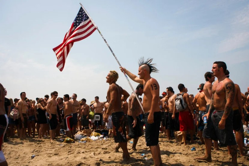 Competitors celebrate the 4th of July by participating in the annual Iron Man on Friday, July 4, 2008 in Hermosa Beach, Calif. Competitors haul themselves, flags, and beer into the air to celebrate Independence Day and show their patriotism as part of the Iron Man competition. In the Iron Man, a Hermosa Beach 4th of July tradition for 32 years, participants must run a mile, paddle board a mile, then chug a six-pack of beer, awards are given to those who do not puke Ð and those who puke the best. © 2008 Patrick T. Fallon