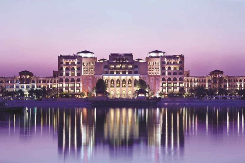 The Shangri-la Qaryat al Bari has a spectacular view of the canal at night, with the Sheikh Zayed Mosque in the skyline.  Courtesy Shangri-La Hotels