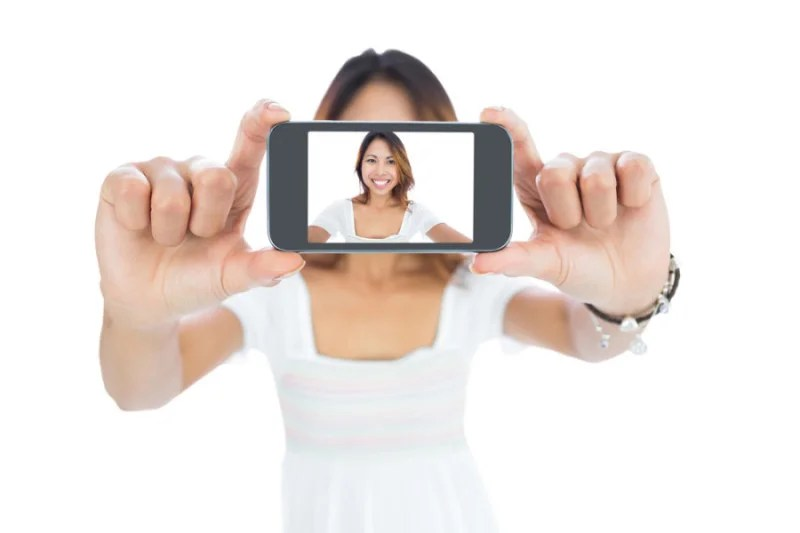 http://www.shutterstock.com/pic-156880373/stock-photo-happy-asian-woman-taking-a-selfie-using-her-smartphone.html?src=mD9Dkr5WJsa1PWfhiytGQA-1-16