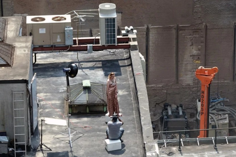 I had a view of a rooftop fashion shoot.