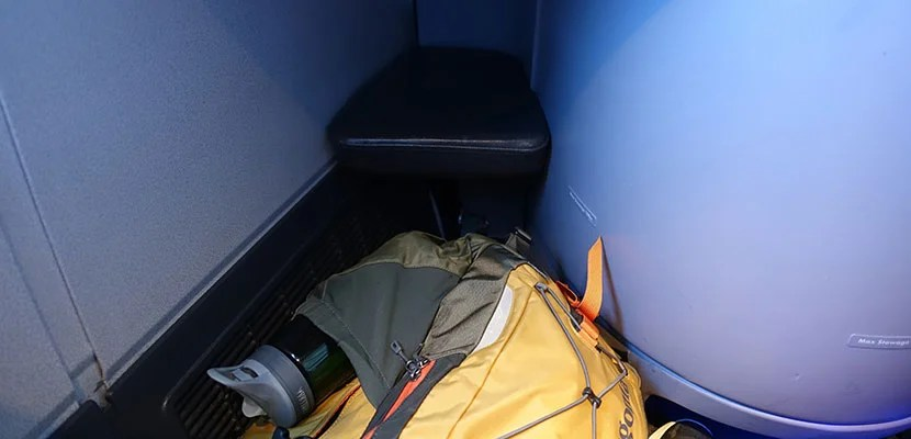 My backpack wouldn't fit under the foot rest, so I had to stow it in the overhead bins.