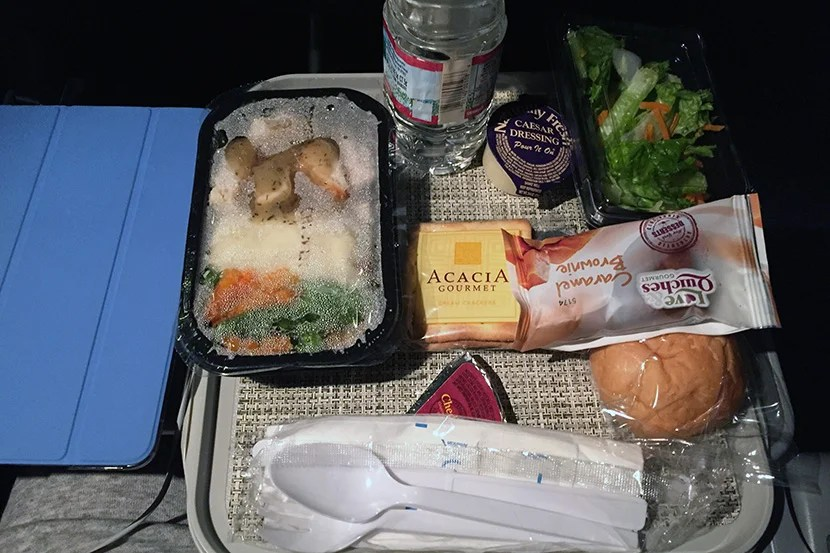 My chicken entrée in economy was nearly inedible — but thankfully, I had already eaten dinner before boarding the plane.