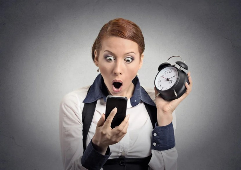 Even people in stock photos can lose track of time. Photo courtesy of Shutterstock.
