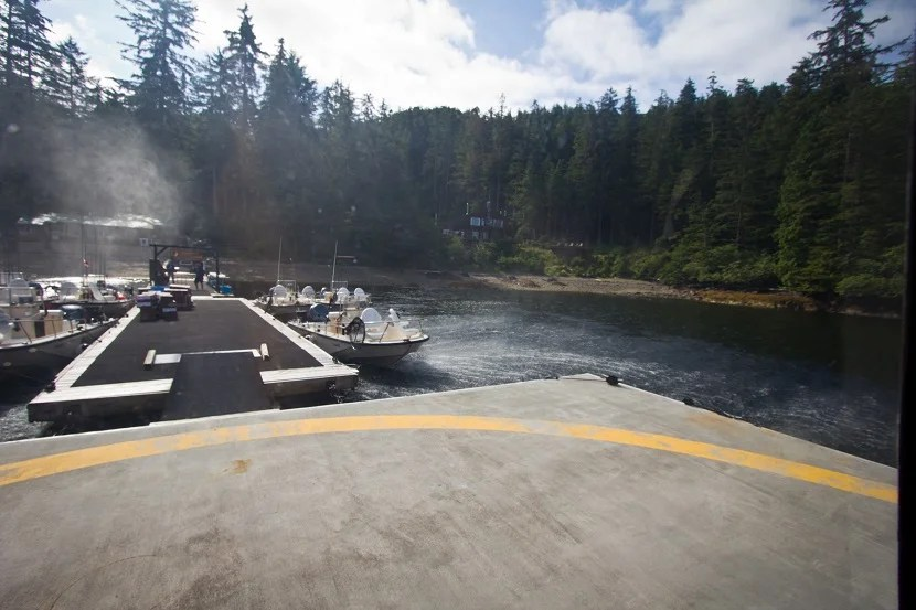Landing on the helipad at The West Coast Fishing Club.  You can see the private cabin, called The Outpost, nestled among the trees.