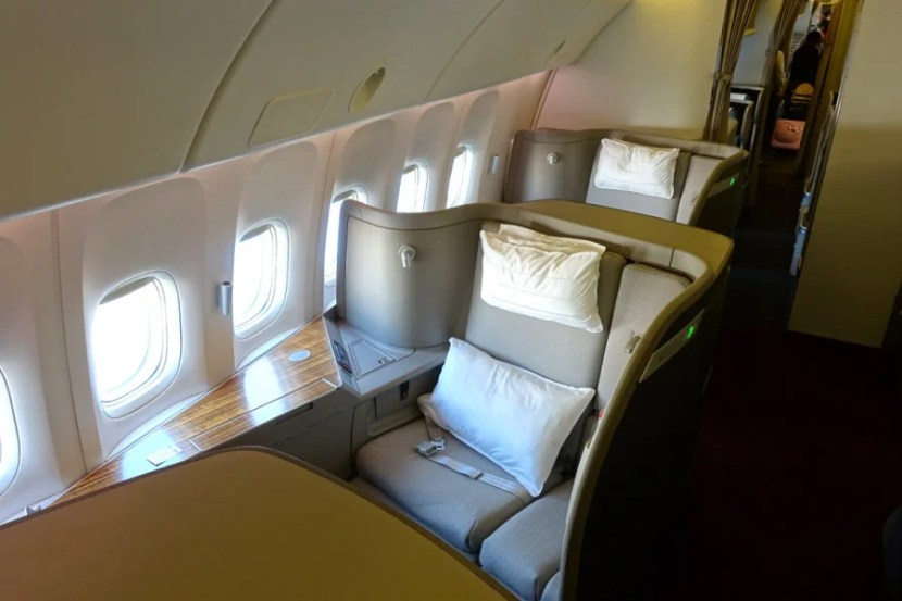 Cathay Pacific's regional business class is a HUGE downgrade from long-haul first class (above).