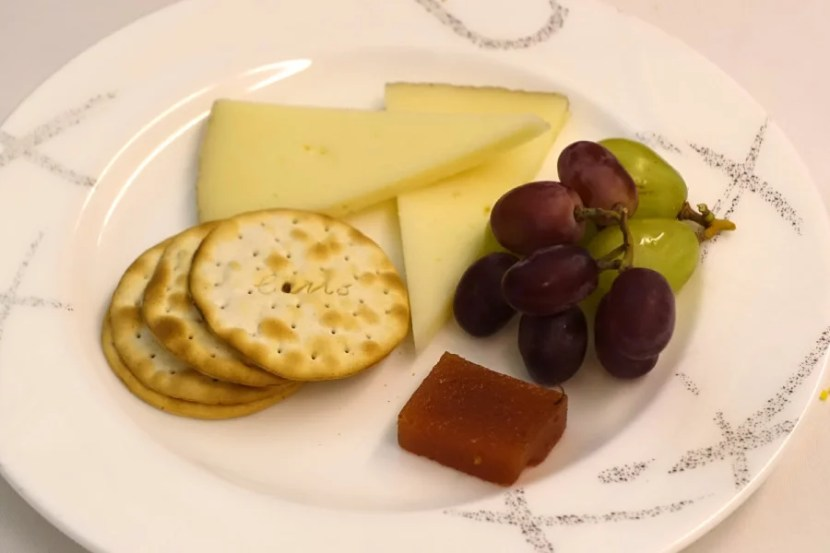 Cheese was served with grapes and a sweet jam.