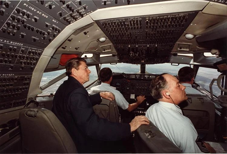 President Reagan sitting with the crew in the cockpit of Air Force One in 1982. Photo courtesy: Reagan Foundation.
