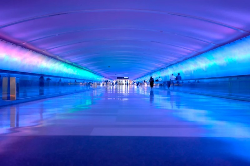 Airport tunnel that glows. Photo courtesy of Shutterstock.