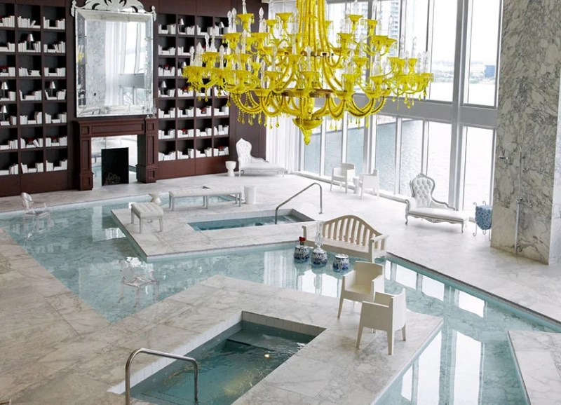 An iconic Philippe Starck chandelier hanging above the 5,000 sq. ft. water lounge. Photo courtesy of Viceroy Miami.