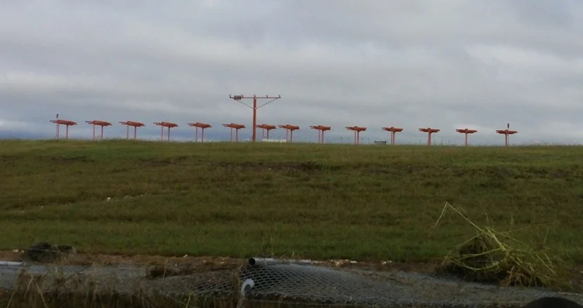 Much of the fence on the south side of 17R/35L runway was knocked down during the storms.
