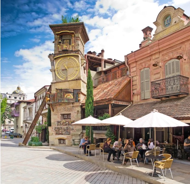 "Café Gabriadze sits at the foot of Tbilisi's own ""leaning tower"" and is a great stepping off point into the old city. Photo courtesy of Shutterstock."