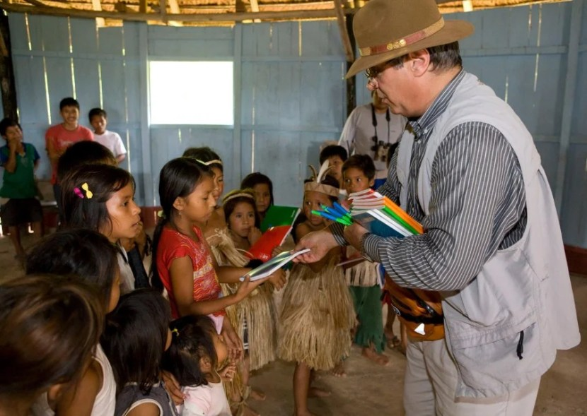 A Pack For Purpose traveler hands out supplies in Peru. Photo courtesy of the Pack For Purpose Facebook page.
