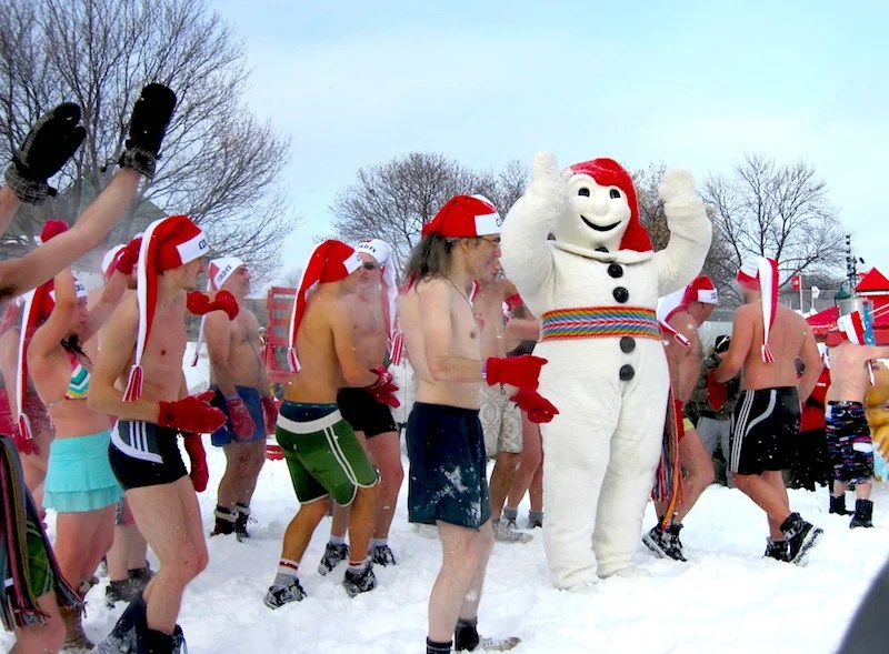 "Carnival de Quebec's famous mascot Bonhomme leads the annual ""snow bath."" Photo by Kelsy Chauvin."