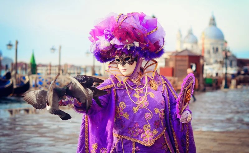 Masquerades are on parade at Venice's Carnevale. Photo courtesy of Shutterstock.
