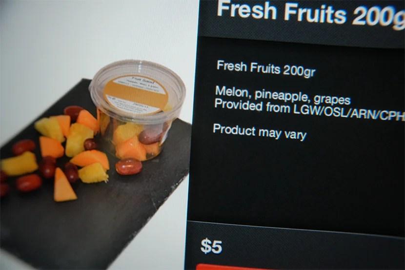 Ordering fresh fruit options via IFE screen.